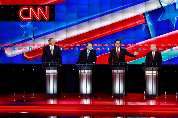 The candidates for the first debate, Governor George Pataki, Mike Huckabee, Rick Santorum and Lindsey Graham take the stage for the CNN Republican Debate in Las Vegas, Nevada at the Venetian Theater in the Venetian Hotel.