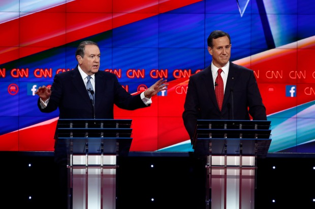 Mike Huckabee and Rick Santorum on stage at the CNN Republican Debate in Las Vegas, Nevada at the Venetian Theater in the Venetian Hotel.